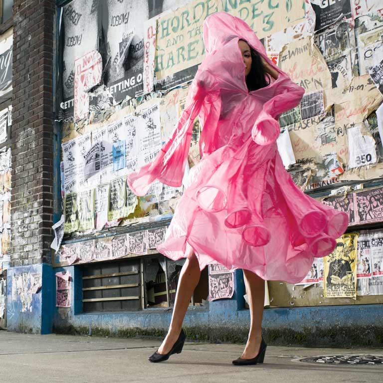 Model in a pink dress made of plastic bags.
