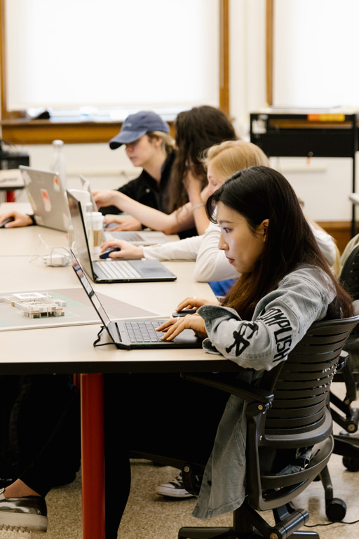 Four students working on computers.