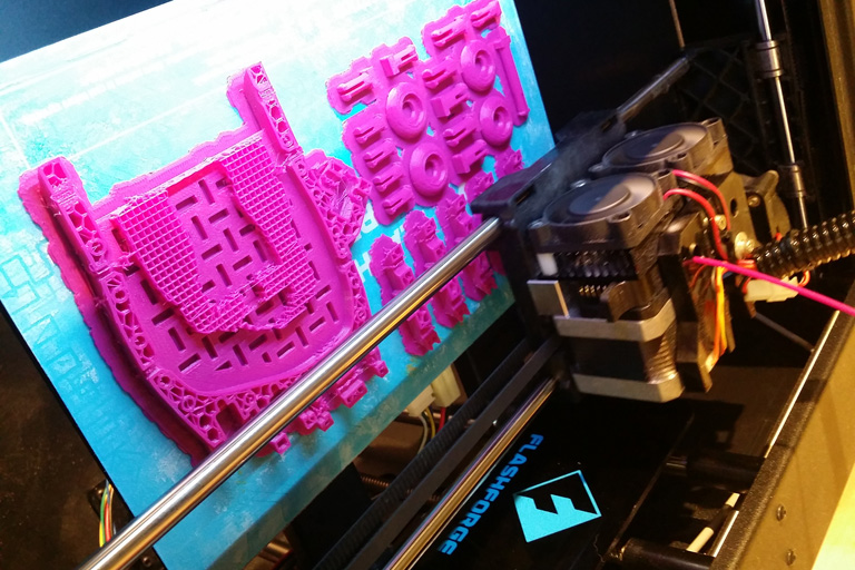 A 3D printer makes something pink.