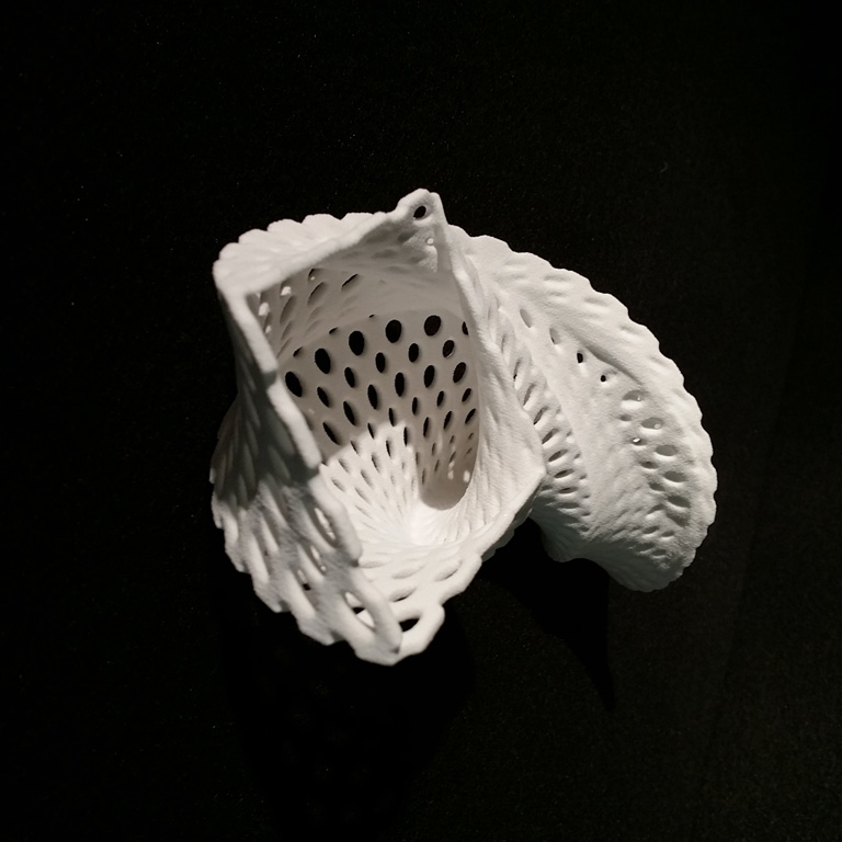 A white object made by a 3D printer.