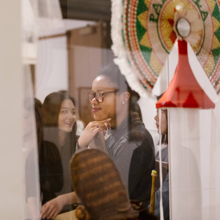 A student looks at a museum exhibition.