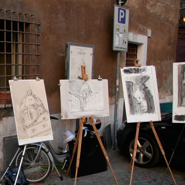 Drawings of architecture in front of a building.