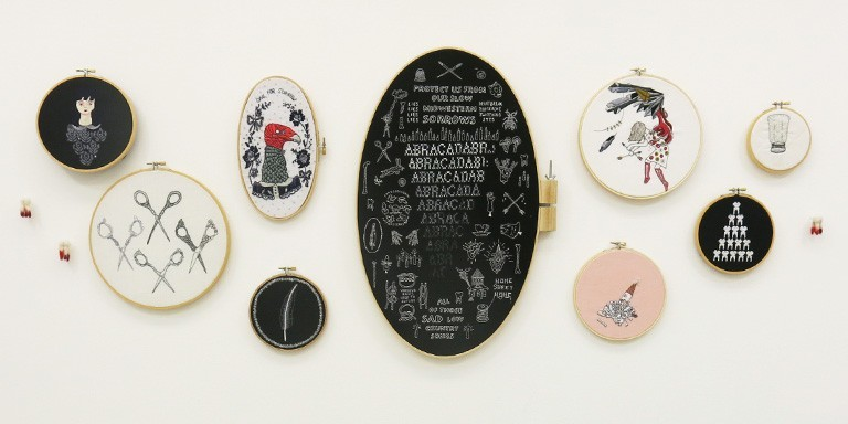 A series of oval art pieces on a wall.