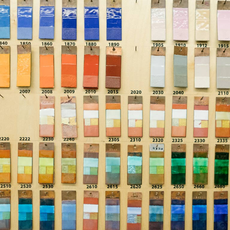 Color swatches hang on a wall.
