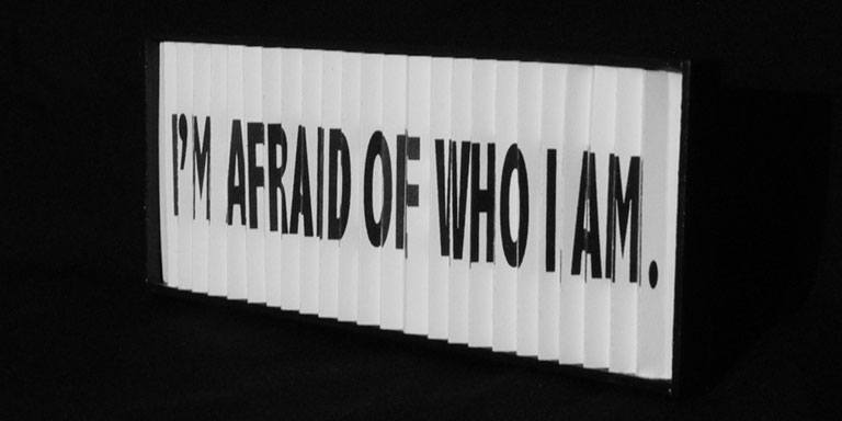 "A sign that says ""I'm afraid of who I am"""