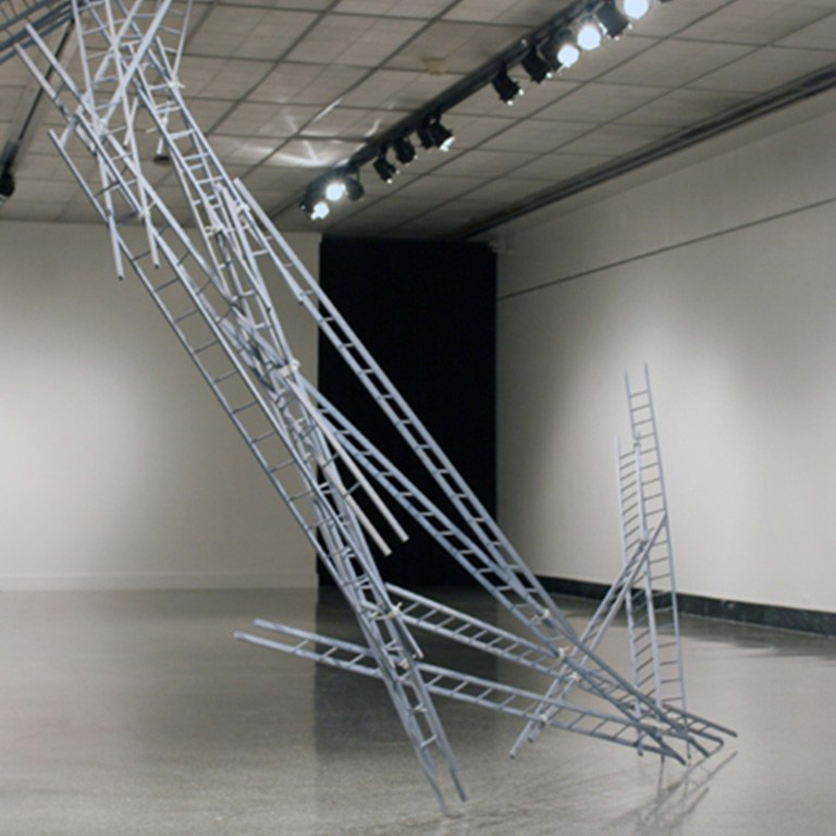 A sculpture using multiple ladders.