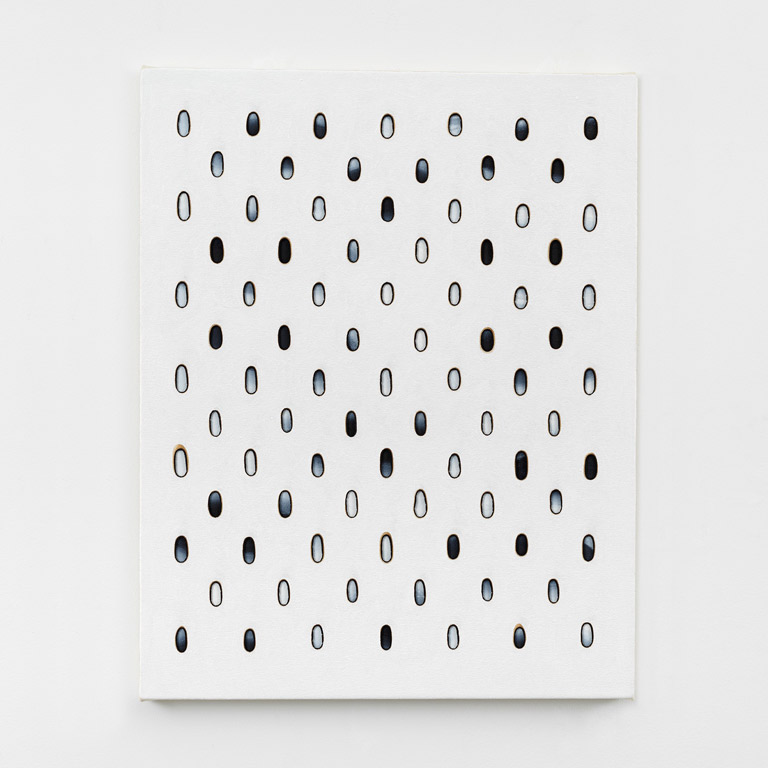 White artwork with blue dots.