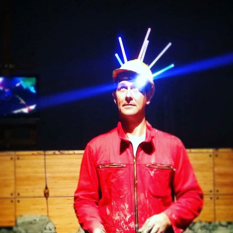 A photo of a person wearing lights on their head.
