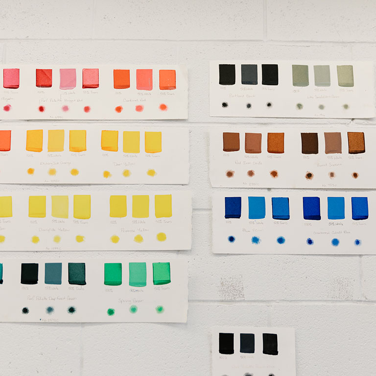 Paint swatches on a wall.