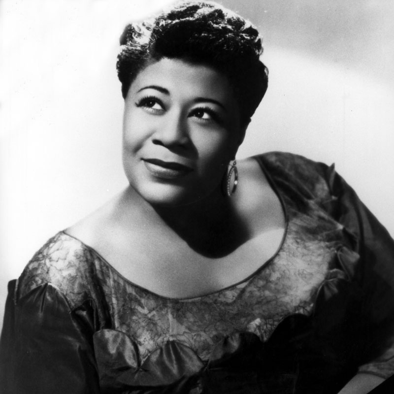 A person (Ella Fitzgerald) smiles away from the camera.