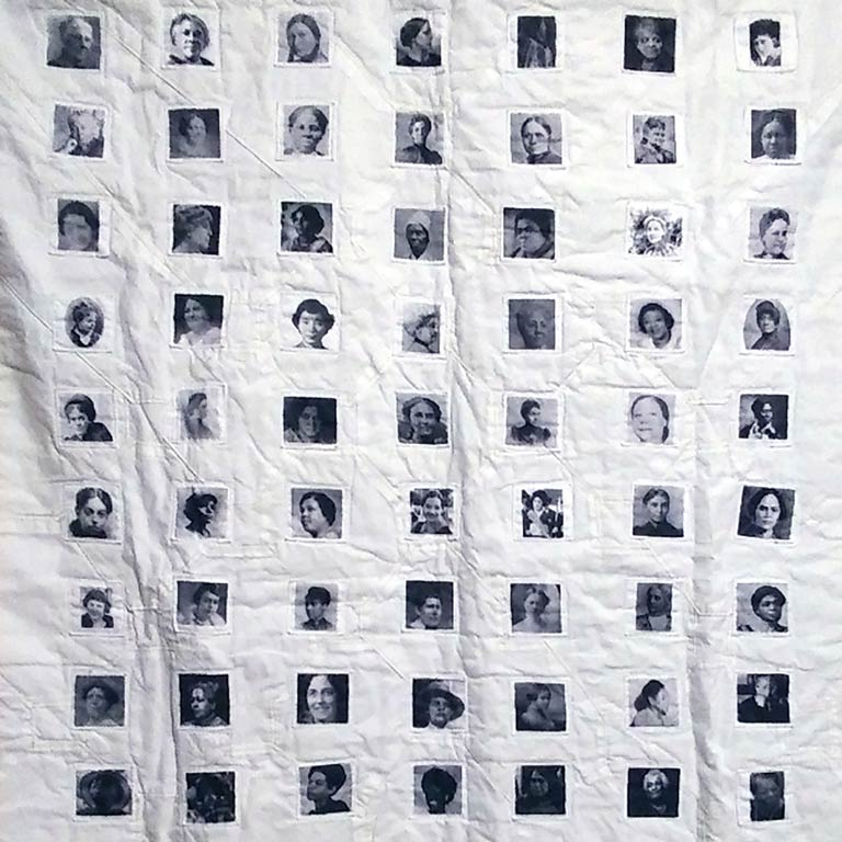 A detail of a quilt with the images of 63 suffragists of color in black and white.