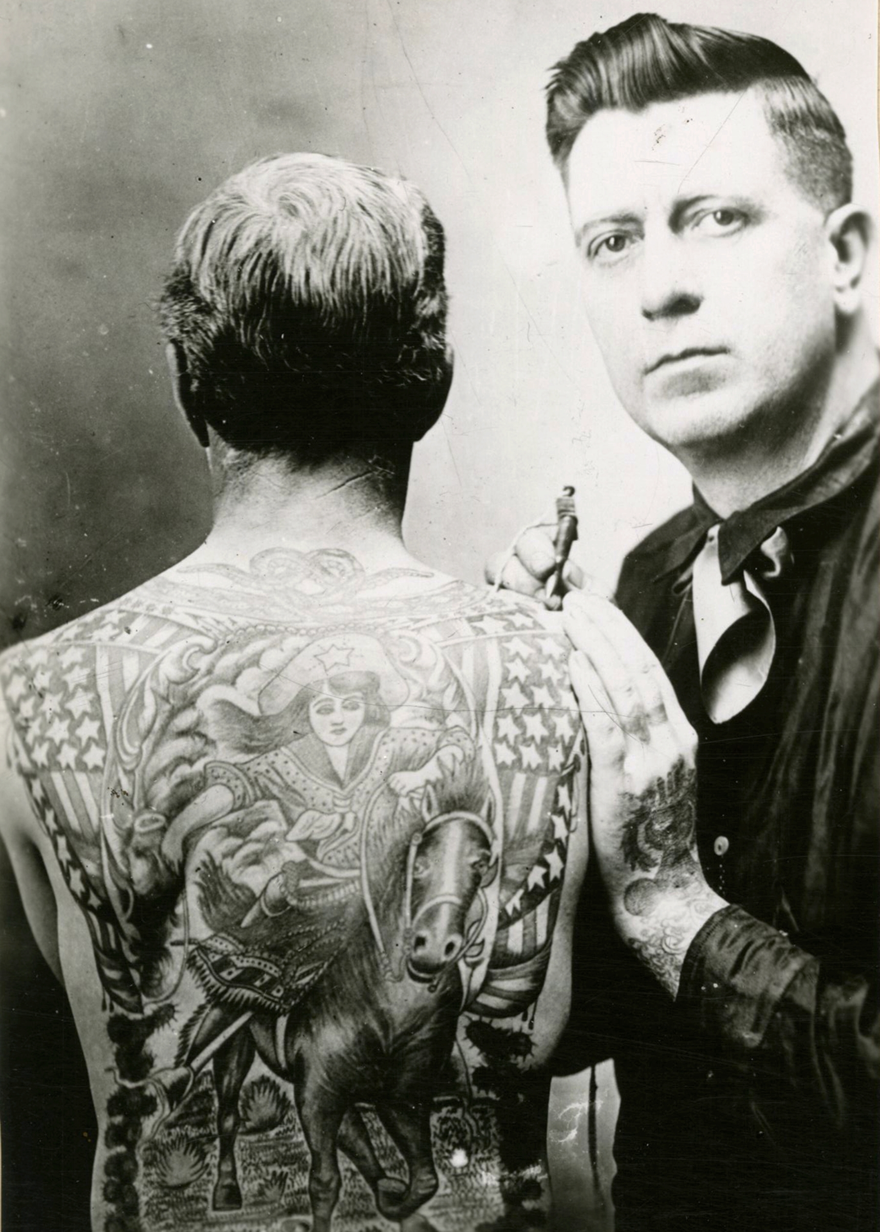 A man with tattoos on his back.