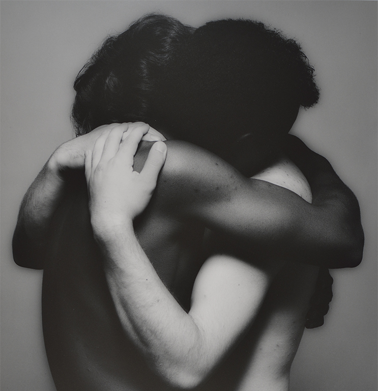 Two people embrace.