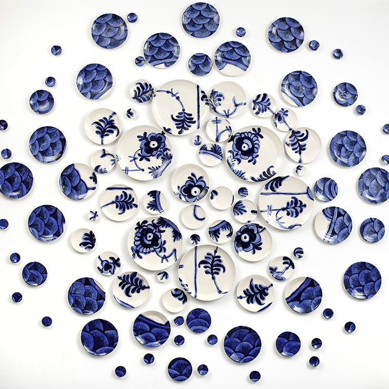 Blue and white plates on a wall