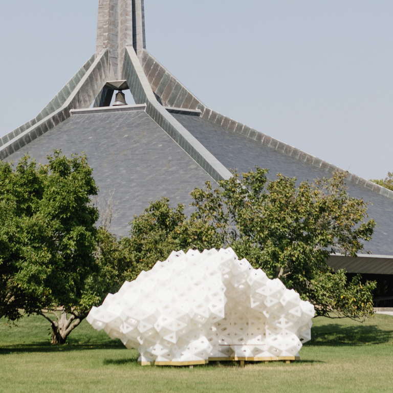 A white abstract outdoor sculpture