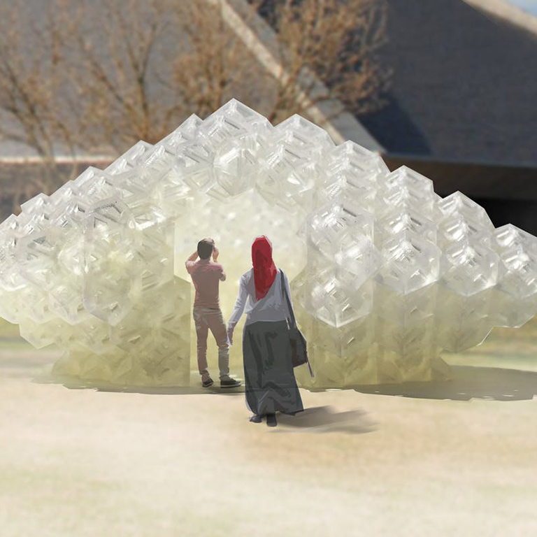 Two people stand in front of a large white abstract sculpture