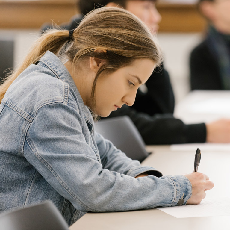 A student works on their paper.